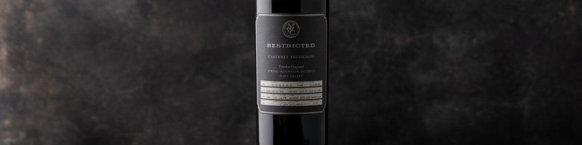 Single bottle of Restricted Cabernet against a dark background