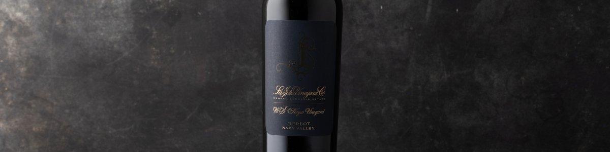 La Jota W.S. Keyes Merlot bottle shot against a dark background