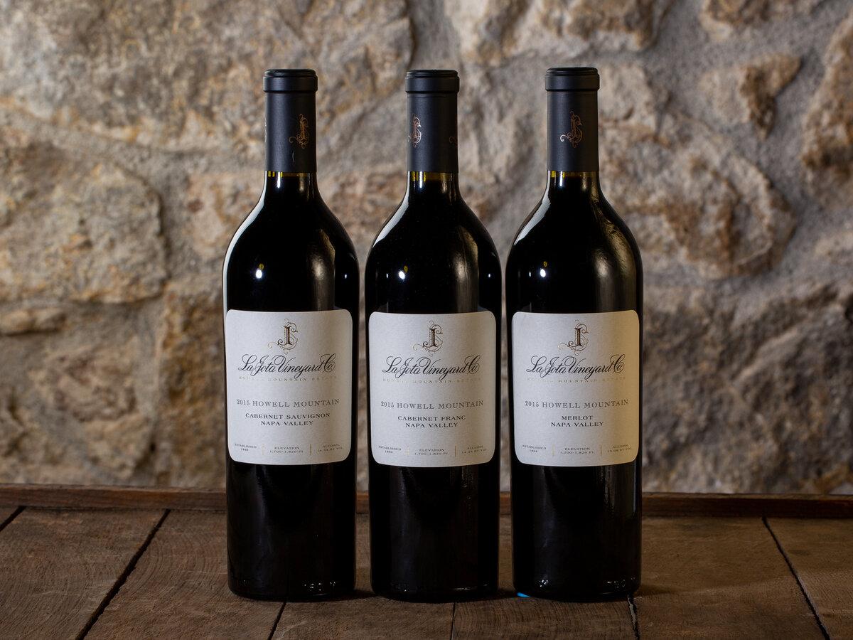 Three bottles of La Jota Vineyard wine lined up on a table